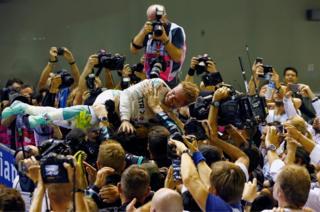Mercedes driver Nico Rosberg of Germany celebrates winning the race