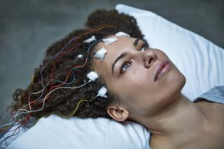 Jennifer Brea with electrodes attached to her head