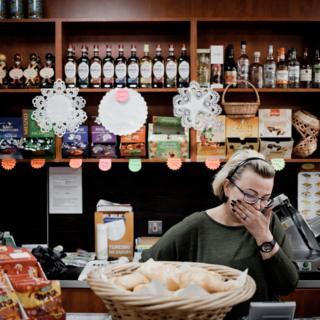 Agata Zyska Olejniczak, Polish. She runs a food shop.