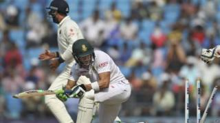 South African batsman Faf du Plessis looks back at his shattered stumps as he is bowled out by Indian spinner Amit Mishra, on the third day of the third cricket test match between the two countries in Nagpur, India, Friday, Nov. 27, 2015