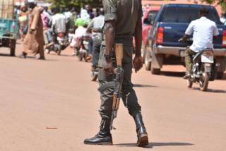A picture taken on 29 October 2018 shows a policeman patrolling in the centre of Ouahigouya, eastern Burkina Faso.