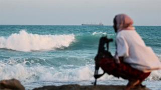 A Somali pirate keeping vigil near Hobyo, in Somalia - Archive shot