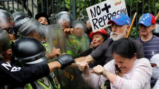 Demonstrators strife with proof troops during Grandparents Mar in Caracas