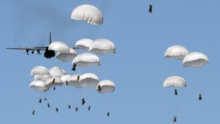 Polish troops land with parachutes on June 7, 2016, as part of the NATO Anaconda-16 military exercise