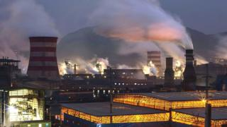 Coal emissions billowing from a steel factory in Hebei, China