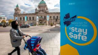 Woman pushing pram in Belfast