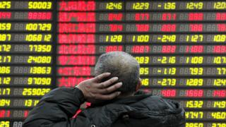 Man looks at stock markets in Asia