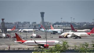 Planes are seen parked at Mumbai airport, Many flights has been cancelled during the outbreak of the new Coronavirus, COVID-19.