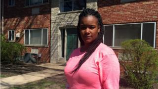 Lashonda Moreland outside of the home where she was arrested