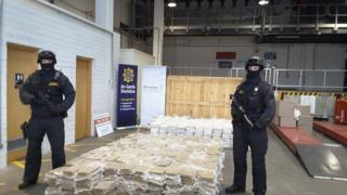 Armed Gardaí (Irish police) pose with an estimated €37.5 million worth of cannabis