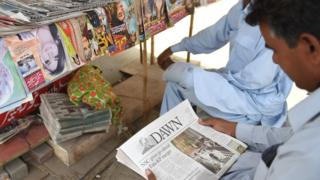 A man reads the Dawn newspaper in Karachi, Pakistan. Photo: May 2018