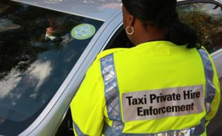 Taxi compliance officer and driver