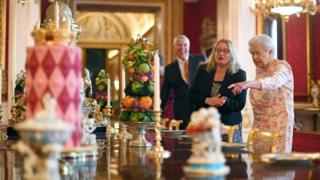The Queen looks around the exhibition at Buckingham Palace