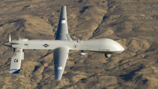 A US Air Force MQ-1 Predator unmanned aerial vehicle flies near the Southern California Logistics Airport in Victorville, California