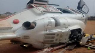 A photo of the helicopter that crashed near Kabba Township Stadium in Nigeria tweeted by a member of Yemi Osinbajo's media team