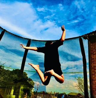science Boy on trampoline