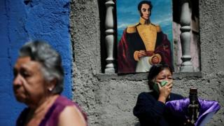 A woman wearing protective face mask reacts as The Nazarene of St Paul procession passed-by despite a nationwide quarantine due to the coronavirus disease (COVID-19) outbreak in Caracas, Venezuela April 8, 2020