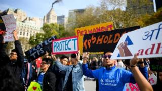People take part in a rally in support of DACA and TPS on 26 October, 2019 in New York City.