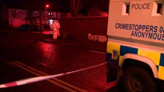 Police officers at the scene of a shooting in west Belfast