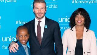 Livey Van Wyk et son fils Remi aux côtés de David Beckham lors du 70ème anniversaire de l'UNICEF au Siège de l'ONU, le 12 décembre 2016, à New York.