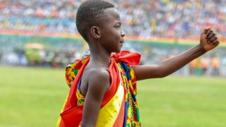 in_pictures A boy in traditional dress marching during independence celebrations in Kumasi, Ghana - Friday 6 March 2020