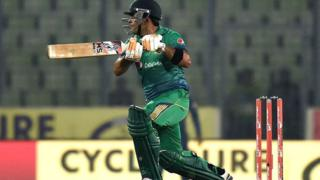 Pakistan cricketer Umar Akmal plays a shot during the Asia Cup T20 cricket tournament match between Pakistan and Sri Lanka