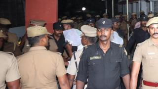 Police stand guard as the accused are brought to court in Chennai, India, July 17, 2018