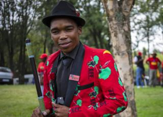in_pictures An EFF member in a red EFF print jacket in Johannesburg, South Africa - Friday 28 February 2020