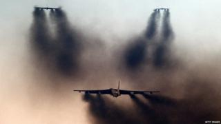 B-52s release smoke during drill