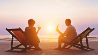 Couple on beach in sun