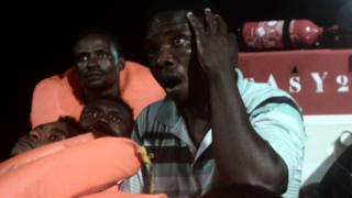 A picture from the NGO SOS Méditerranée shows migrants being rescued before boarding the Aquarius
