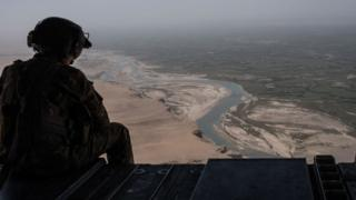 A US Army helicopter flies over Camp Shorab in Helmand Province, Afghanistan.