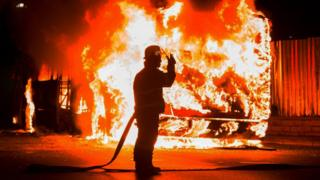 A fireman near a burning bus in Johannesburg, South Africa - Tuesday 25 October 2016