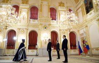 "Russian President Vladimir Putin (C), accompanied by Foreign Minister Sergei Lavrov (2nd R) and presidential Aide Yury Ushakov (R), receives diplomatic credentials from Benin""s ambassador to Russia Rene Coto Sounon during a ceremony at the Kremlin in Moscow on March 16, 2017"