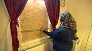 Window boarded up after racist attack on family home