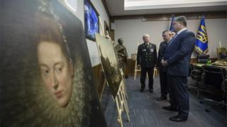 Ukrainian President Petro Poroshenko (front) looks at the recovered paintings. 11 May 2016