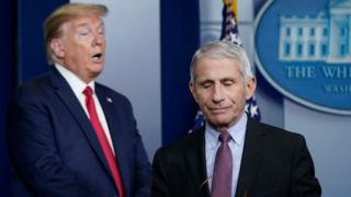 Dr. Anthony Fauci (R), director of the National Institute of Allergy and Infectious Diseases, and U.S. President Donald Trump participate in the daily coronavirus task force briefing at the White House on April 22, 2020