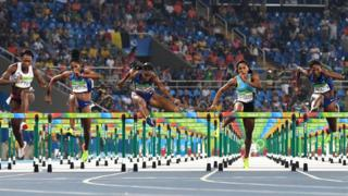 Cindy Ofili, Kristi Castlin, Brianna Rollins, Pedrya Seymour and Nia Ali competing in the women's 100m hurdles final