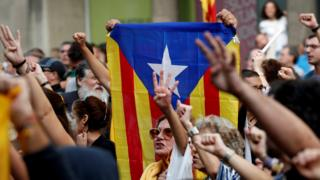 Catalan independence supporters hold an Estelada (Catalan Separatist flag) in their hands as they protest during a protest against the impending verdict of the Spanish Supreme Court on 13 October 2019