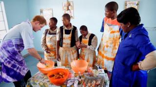 Prince Harry cooking with children in Lesotho