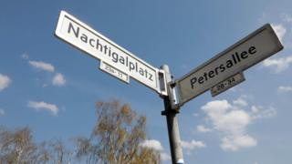 "View taken on April 12, 2018 shows the plates with the street names ""Petersallee"" and ""Nachtigalplatz"" in the so-called African Quarter in the northwest of Berlin."