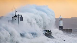 Waves crashing over Porthcawl harbour