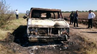 Mexican authorities inspect a burnt out van suspected to belong to a couple of Australian tourists missing for more than a week, in Sinaloa, Mexico on 21 November, 2015.