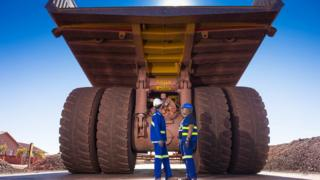 Workers check a truck at Anglo American's Kolomela mine in South Africa