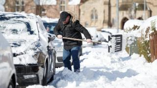 Man digs out car from snow