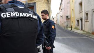 Police outside the raided flat in Montpellier (10 Feb)