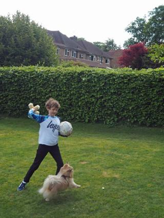 William playing in his garden with Teddy