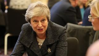 Theresa May speaking to business figures in Northern Ireland