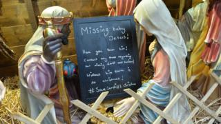 Nativity with a sign advertising missing Jesus at Cardiff Christmas Markets