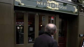 A man walks past a Wetherspoon in Dublin